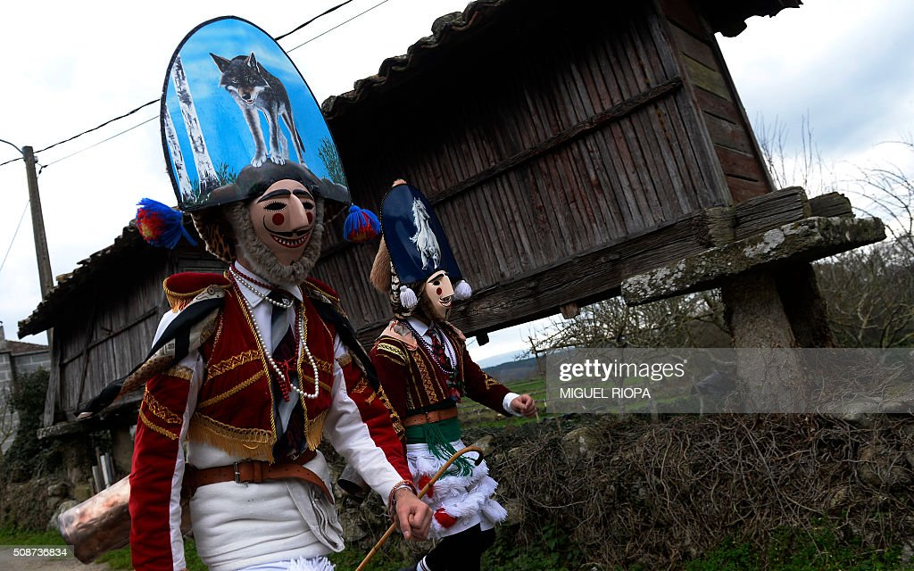 People dressed as 'Felos' parade during the traditional and ancestral carnival close to the village of Maceda northwestern Spain on February 6, 2016. The 'Felos ' represent anarchic and rebellious spirits meant to instill fear into anyone who approaches them and are the 'authority' during the week of Carnival, meaning they can break the rules.The mask represents virility. AFP PHOTO/ MIGUEL RIOPA / AFP / MIGUEL RIOPA