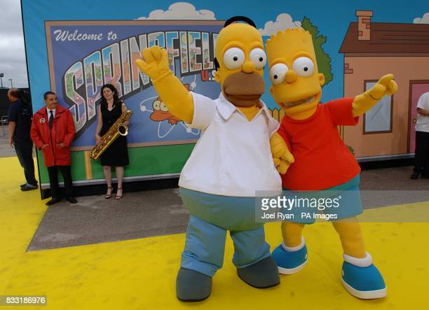 People dressed as Homer and Bart Simpson arrive for the UK Premiere of The Simpsons Movie at the Vue Cinema The O2 Peninsula Square London