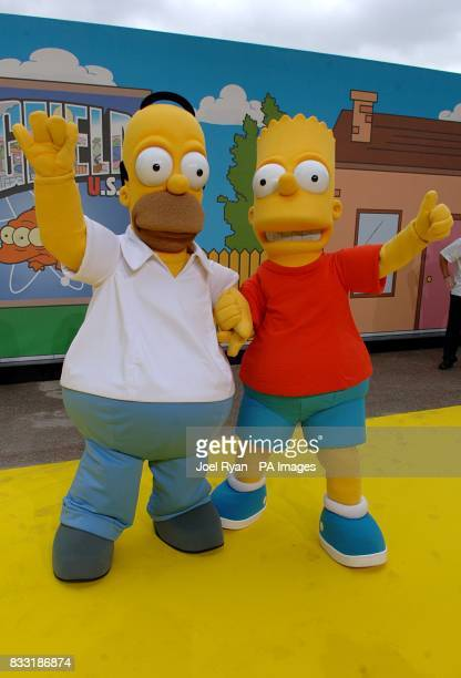 People dressed as Homer and Bart Simpson at the UK Premiere of The Simpsons Movie at the Vue Cinema The O2 Peninsula Square London