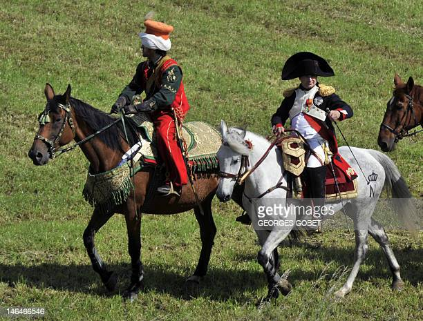 People dressed as Napoleon and his servant Rustam reenact the 1815 Battle of Waterloo between the French army led by Napoleon and the Allied armies...