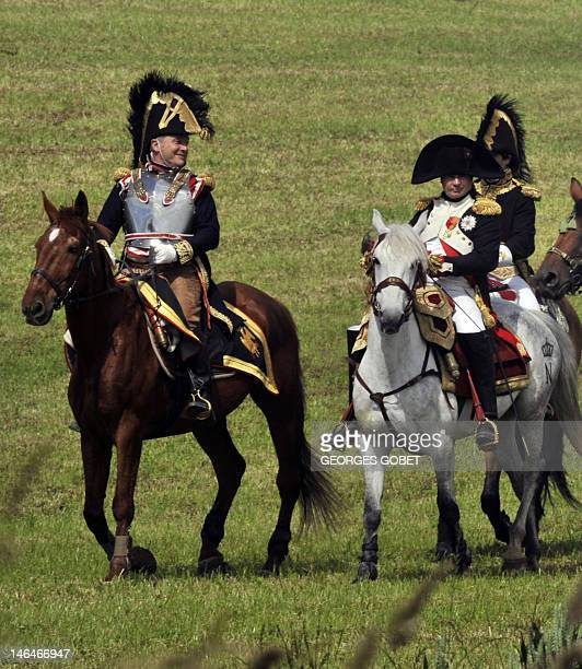 People dressed as Napoleon and his staff reenact the 1815 Battle of Waterloo between the French army led by Napoleon and the Allied armies led by the...