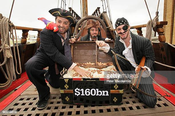 People dressed as pirates protest for the Christian Aid charity against tax avoidance on the Golden Hind ship on September 3 2009 in London England...