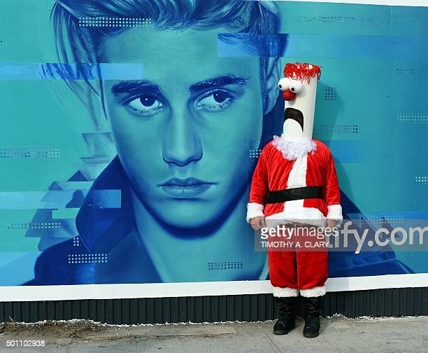 People dressed as Santa and other holiday related outfits start their parade around the Brooklyn section of the city during the SantaCon 2015 in New...