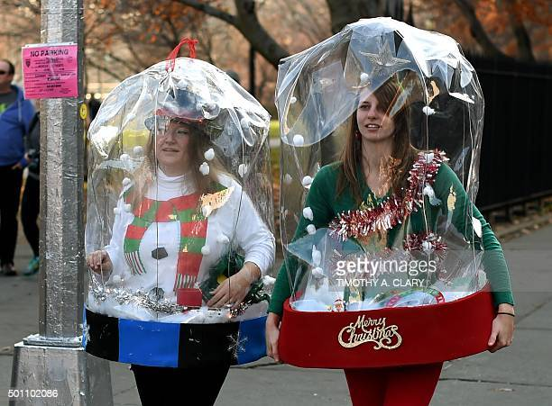People dressed as Santa Claus and other holiday related outfits gather in Brooklyn's McCarren Park during the SantaCon 2015 in New York City December...
