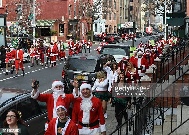 People dressed as Santa Claus and other holiday related outfits start their parade after meeting in Brooklyn's McCarren Park during the SantaCon 2015...