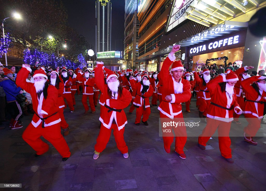 People dressed as Santa Claus dance 'Gangnam Style' on Christmas Eve December 24, 2012 in Wuhan, China. Though Christmas is not officially celebrated in China, the holiday is becoming increasingly popular as Chinese adopt more Western ideas and festivals.