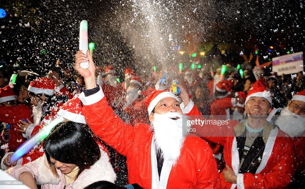People dressed as Santa Claus march on Christmas Eve December 24, 2012 in Foshan, China. Though Christmas is not officially celebrated in China, the holiday is becoming increasingly popular as Chinese adopt more Western ideas and festivals.