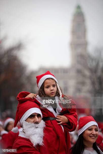 People dressed as Santa Claus participate in the annual Santa Claus parade in downtown Porto on December 12 2010 Thousands staged a parade in an...