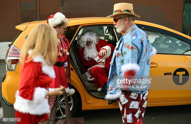 People dressed as Santa gather in Brooklyn's McCarren Park during the SantaCon 2015 in New York City December 12 the 21st anniversary of the event...
