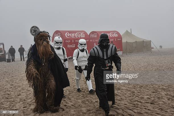 People dressed as Star Wars character Darth Vader and other characters attend the Epiphany holiday celebration near the seashore in Odessa Ukraine on...