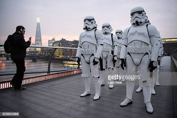 People dressed as Stormtroopers from the Star Wars franchise of films pose on the Millennium Bridge to promote the latest release in the series...