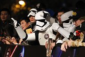 People dressed as Stormtroopers gesture at the red carpet event for the premiere of 'Star Wars The Force Awakens' on December 27 2015 in Shanghai...