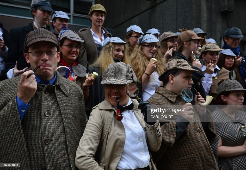 People dressed as the fictional detective created by the late Sir Arthur Conan Doyle, Sherlock Holmes, gather in central London on July 19, 2014 as they attempt to set the world record for the highest number of people dressed as Sherlock Holmes gathered in one place. The gathering was a fund-raising event with money raised going toward the restoration of Sir Arthur Conan Doyle's study and the stained glass windows at his former home, Undershaw.