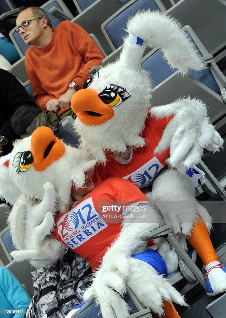 People dressed as the handball mascots chat during the the 2012 EHF European Women's Handball Championship Group II match between Czech Republic and Denmark on December 10 , 2012, at the Kombank Arena in Belgrade. Denmark won 33-30.