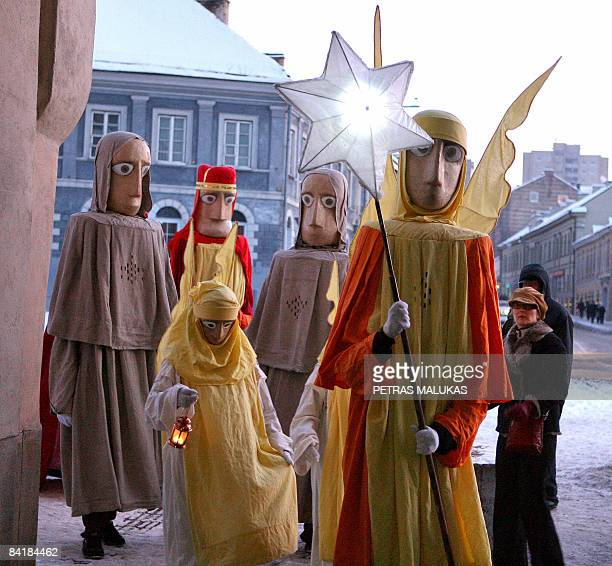 People dressed as the Three Kings along with residents and city guests celebrate the Three Kings day in the old district of Vilnius on January 6 2009...