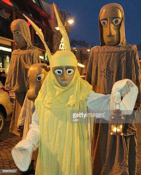 People dressed as the Three Kings along with residents and city guests celebrate the Three Kings day in the old district of Vilnius on January 6 2010...