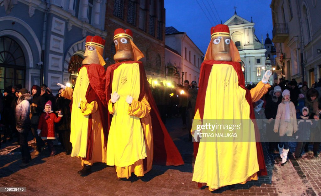 People dressed as the Three Kings walk during a traditional epiphany march in the old district of Vilnius, Lithuania, on January 6, 2013.