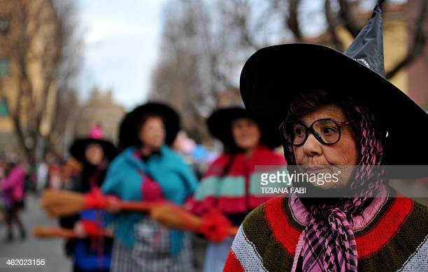 People dressed as the witch Befana carry a 54metre long stocking during the annual Befana procession in Viterbo on January 12 2014 AFP PHOTO /...