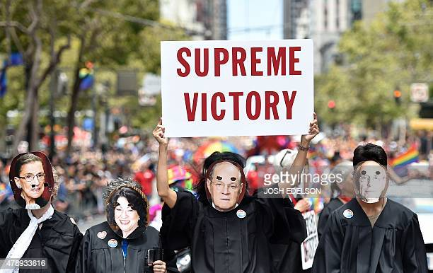 People dressed as United States Supreme Court Justices march along Market Street during the annual Gay Pride Parade in San Francisco California on...