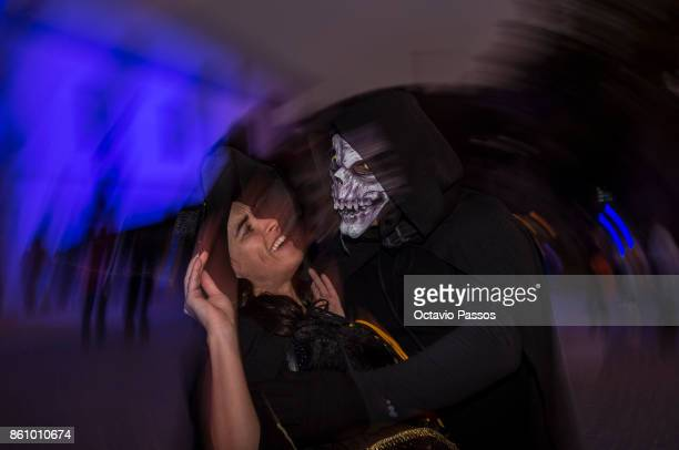 People dressed as witches and as a devil pose on the Witches' Night on October 13 2017 in Montalegre Portugal Witches Night occurs whenever the 13th...