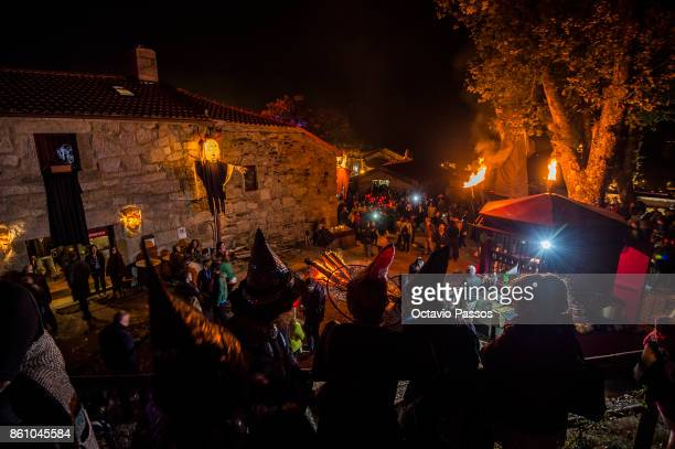 People dressed as witches and devils pose on the Witches' Night on October 13 2017 in Montalegre Portugal Witches Night occurs whenever the 13th...
