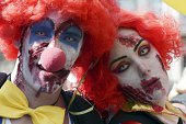 People dressed as zombie clowns take part in the Zombie Walk on September 13 2014 in the eastern French city of Strasbourg within the framework of...