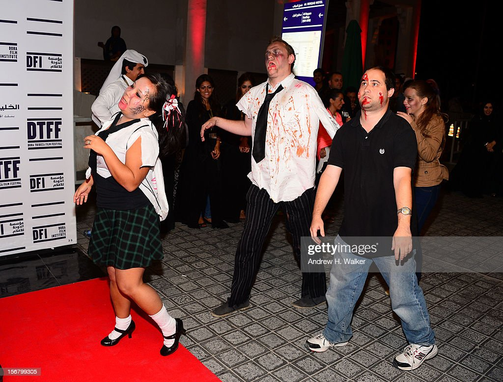 People dressed as zombies attend the' Lockdown: Red Moon Escape' premiere at the Al Mirqab Hotel during the 2012 Doha Tribeca Film Festival on November 21, 2012 in Doha, Qatar.