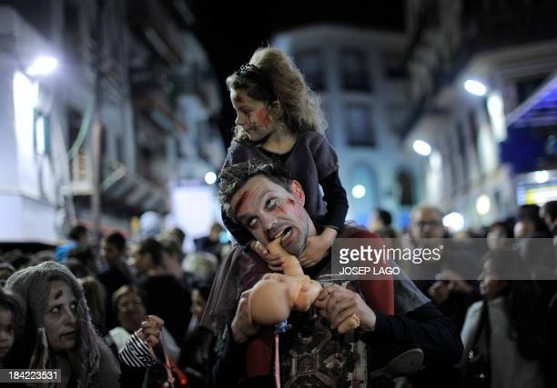 People dressed as zombies take part in a Zombie Walk in Sitges near Barcelona on October 12 2013 AFP PHOTO/ JOSEP LAGO