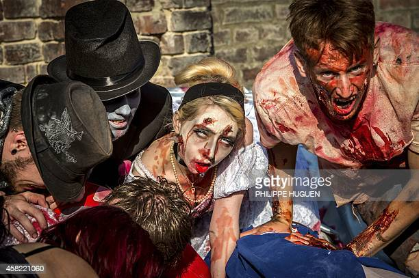 People dressed as zombies take part in a Zombie Walk in the northern French city of Lille on October 1 2014 AFP PHOTO/PHILIPPE HUGUEN