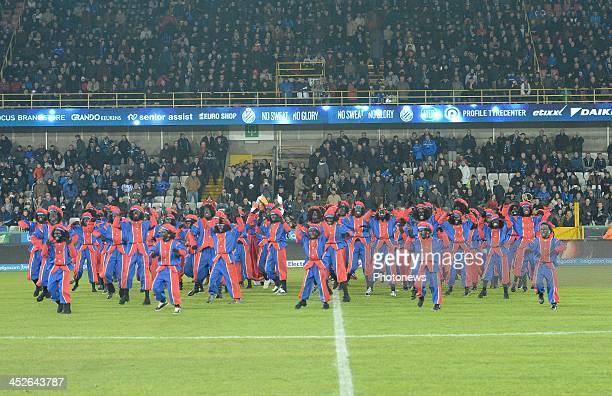 People dressed as 'Zwarte Piet' on the pitch during the Jupiler League match between Club Brugge KV and KV Oostende on November 30 2013 in Brugge...
