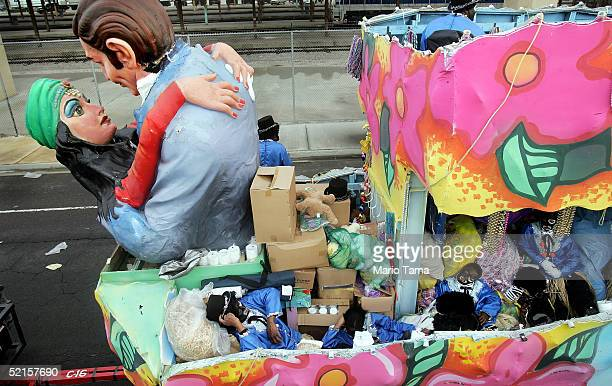 People dressed in blackface catch a nap before the start of the Zulu parade a primarily AfricanAmerican parade during Mardi Gras festivities February...