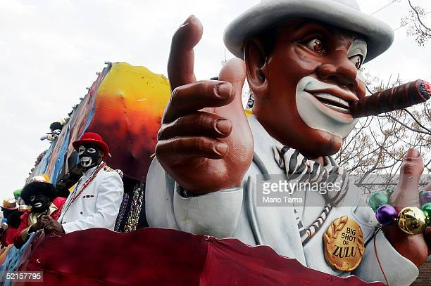 People dressed in blackface ride a float during the Zulu parade a primarily AfricanAmerican parade during Mardi Gras festivities February 8 2005 in...