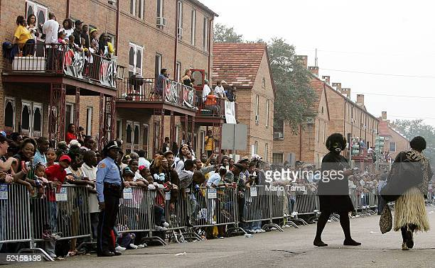 People dressed in blackface walks down the street during the Zulu parade a primarily AfricanAmerican parade during Mardi Gras festivities February 8...
