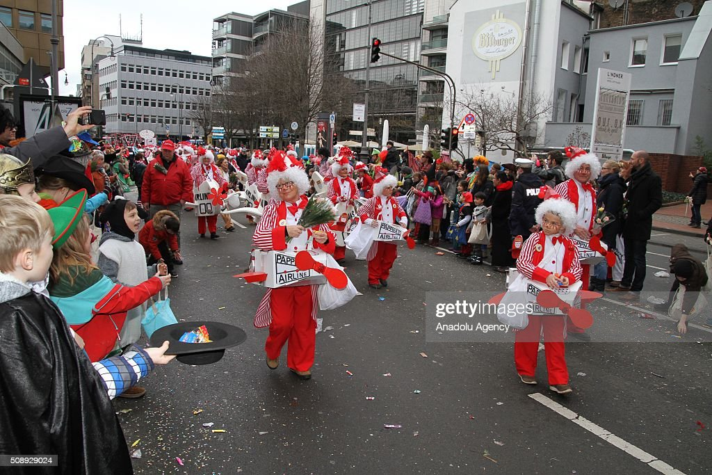 People dressed in costumes attend a parade during Cologne carnival known as 'fifth season of the year' in Cologne, Germany on February 7, 2016. Cologne Carnival is celebrated with parties on the streets, in public squares.