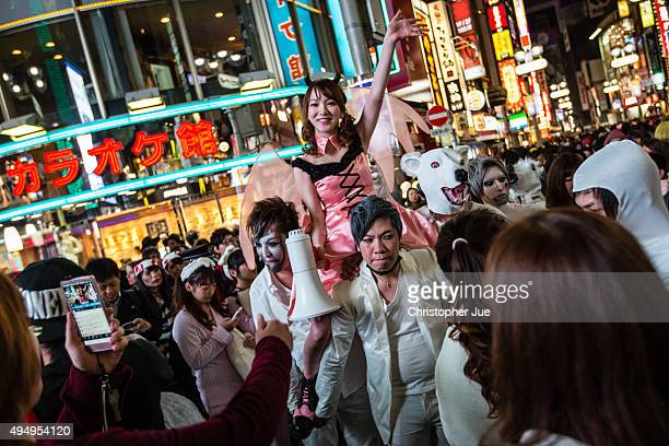 People dressed in Halloween costumes gather in Tokyo's Shibuya district on October 30 2015 in Tokyo Japan Tokyo metropolitan police is expected to...