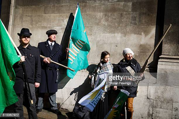 People dressed in historical costumes from the 1916 Easter Rising take part in the St Patrick's Day parade through central London on March 13 2016 in...