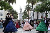 LANFRANCHI People dressed in period costumes dance during a reconstitution of the 'Imperial waltzes' in front of the Napoleon Bonaparte statue on...