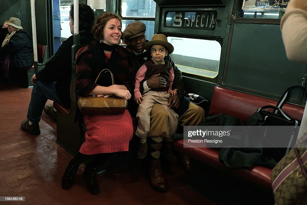 People dressed in period costumes have their picture taken in a vintage New York City subway car on December 16, 2012 in New York City. The New York Metropolitan Transportation Authority (MTA) runs vintage subway trains from the 1930's-1970's each Sunday along the M train route from Manhattan to Queens through the first of the year.