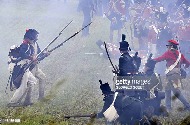People dressed in period uniforms reenact the 1815 the Battle of Waterloo between the French army led by Napoleon and the Allied armies led by the...