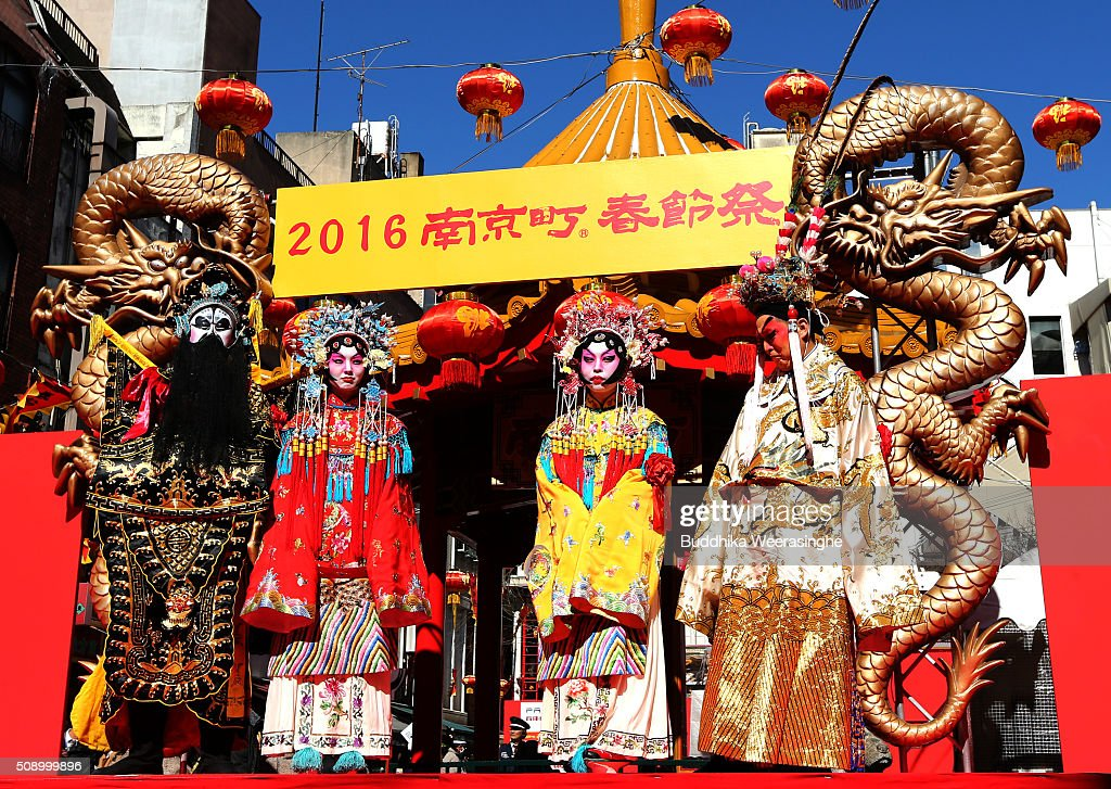People dressed in traditional Chinese costumes perform in celebration of the Chinese New Yearon a stage at the Nankinmachi square, China Town on February 8, 2016 in Kobe, Japan. In Nankinmachi, the district known as Kobe Chinatown, tourists enjoyed Chinese food, lion dance and the parade organized to celebrate the Lunar New Year.