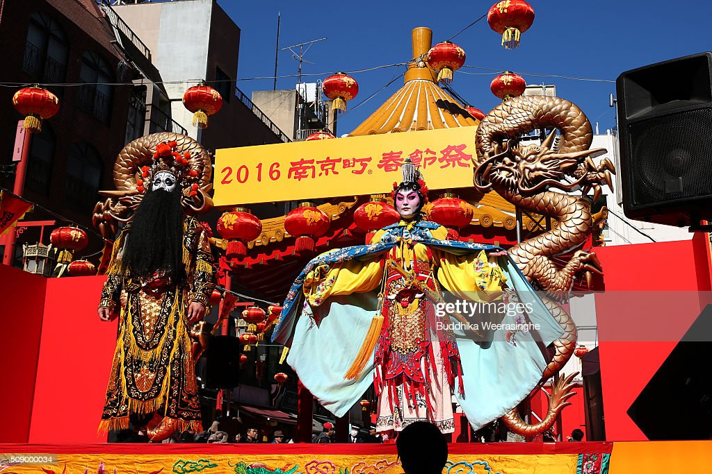 People dressed in traditional Chinese costumes perform to celebrate the Chinese New Year on a stage at the Nankinmachi square, China Town on February 8, 2016 in Kobe, Japan. In Nankinmachi, the district known as Kobe Chinatown, tourists enjoyed Chinese food, lion dance and the parade organized to celebrate the Lunar New Year.