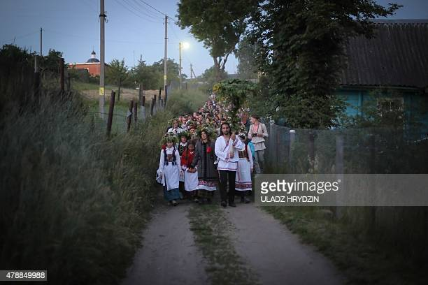 People dressed in traditional clothing celebrate Kupala Night in the Village of Rakau some 30 km west of Minsk on June 27 2015 People celebrate the...