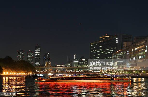 People dressed in traditional costume ride decorated boat along the Okawa river during the annual Tenjin summer festival boat parade on July 25 2013...