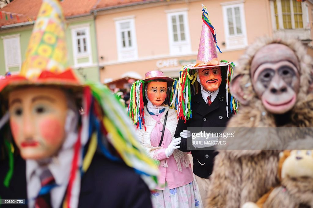 People dressed in traditional Slovenian Handsome costumed parade during the Ptuj carnival in Ptuj, on February 7, 2016. The Ptuj carnival is the largest in Slovenia and last 11 days. / AFP / JURE MAKOVEC