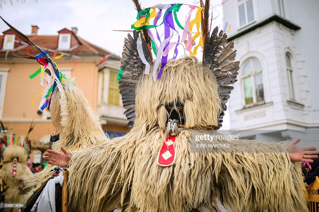 People dressed in traditional Slovenian Kurent costumed parade during the Ptuj carnival in Ptuj, on February 7, 2016. Kurents are characters wearing sheep skin, a mask with a long red tongue, a cow bell, and multi-coloured ribbons on the head, intended to drive away evil spirits of the winter. The Ptuj carnival is the largest in Slovenia and last 11 days. / AFP / JURE MAKOVEC