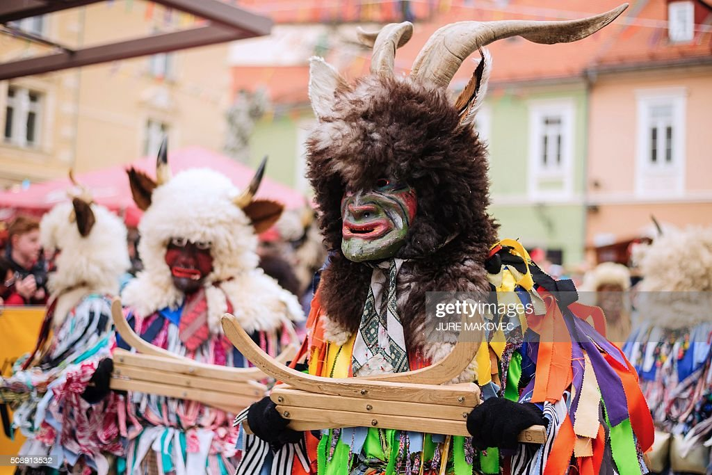 People dressed in traditional Slovenian Pustje costumed parade during the Ptuj carnival in Ptuj, on February 7, 2016. The Ptuj carnival is the largest in Slovenia and last 11 days. / AFP / JURE MAKOVEC