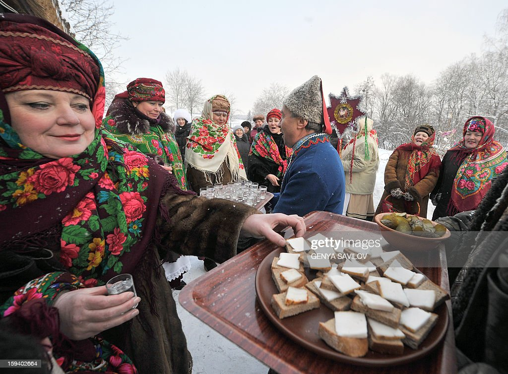 People dressed in Ukrainian traditional costumes celebrate the Malanka festival in the village of Pirogovo, near Kiev, on January 13, 2013. The local population traditionally celebrate Malanka on January 13th, which is New Year's Eve in accordance with the Julian calendar.