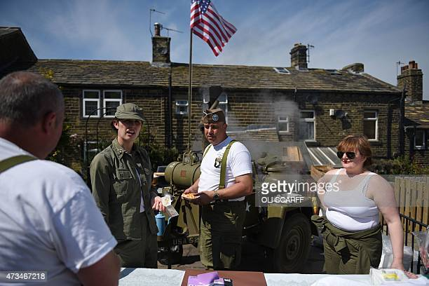 People dressed in US military uniforms run a canteen on the first day of the Haworth 1940s Weekend in Haworth Northern England on May 15 2015 Each...