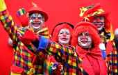 People dressed up as clowns pose at the Monday carnival parade on March 3 2014 in Mainz Germany Rose Monday is the highpoint of the annual carnival...