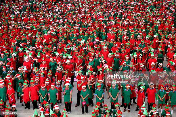 People dressed up as Santa's Elves line up during a photocall for the Guinness World Record at a shopping mall in Bangkok 1762 Thai people dressed up...
